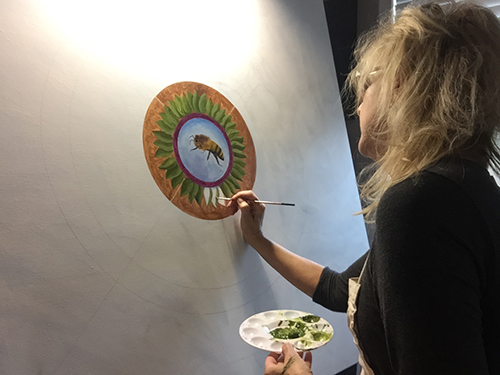 Amy Livingstone painting at her easel